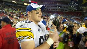 Heath Miller holds the Vince Lombardi Trophy as part of the 2009 Super Bowl Champion Pittsburgh Steelers. Courtesy of Denise and Earl Miller.
